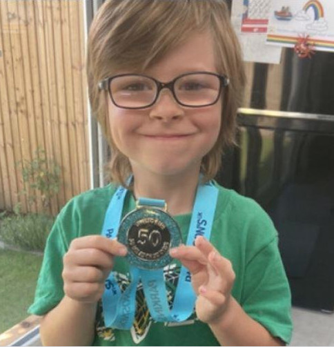 Speedy six-year-old runs 50 miles to raise cash for Parkinson's UK