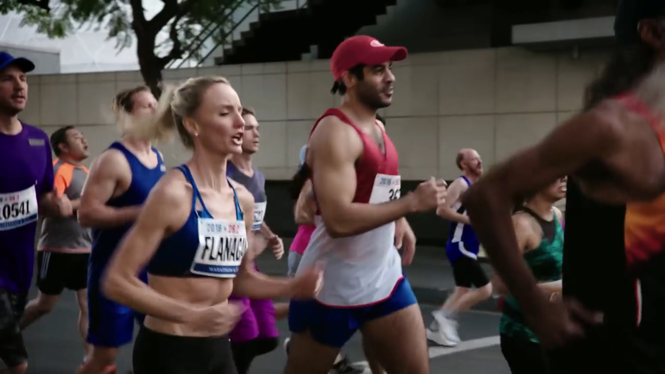 Shalane Flanagan in Super Bowl Ad Spot Lip Syncing While she ran with 100 extras