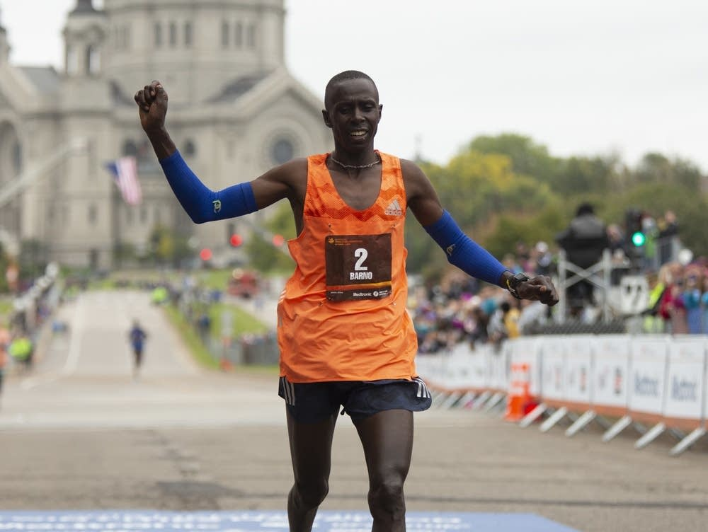 Elisha Barno crosses the finish line to win the men's title at the Twin Cities Marathon on Sunday