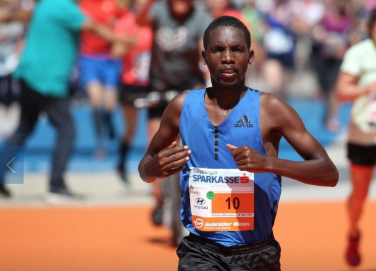 Victor Kipchirchir wins the Salzburg Marathon as the start and finished was moved back to old town