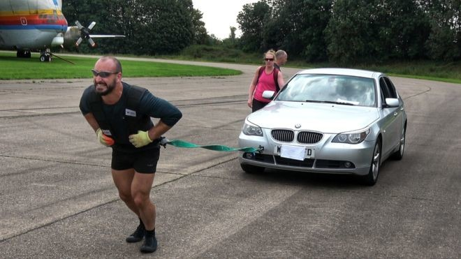 Max Glover, 32, completed the charity challenge pulling a BMW car over the 26.2 mile distance