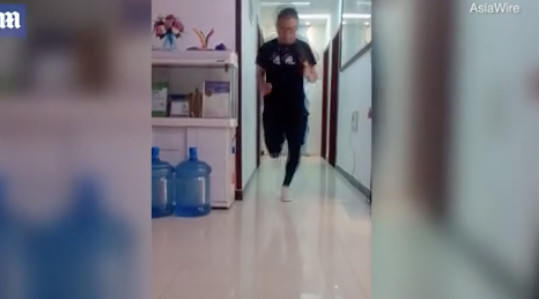 An amateur Chinese marathon runner under coronavirus lockdown ran 31 miles in his living room to pass the time