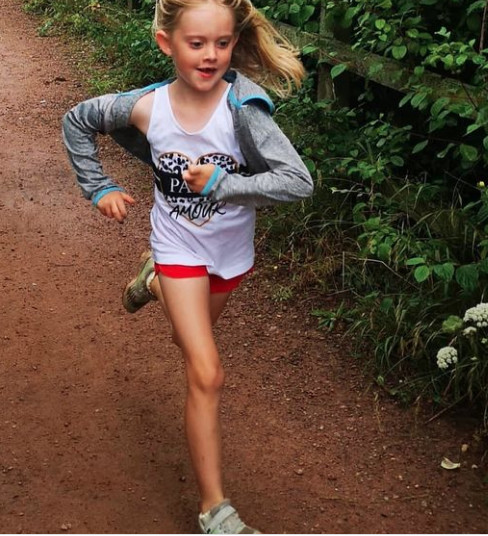 Six-year-old runs marathon to raise money for teacher's illness