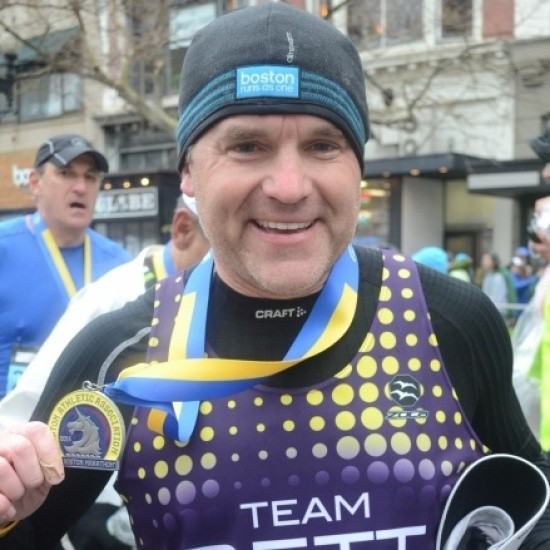 Ryan Enright is running his 22nd consecutive Boston Marathon and this time for Team Joslin
