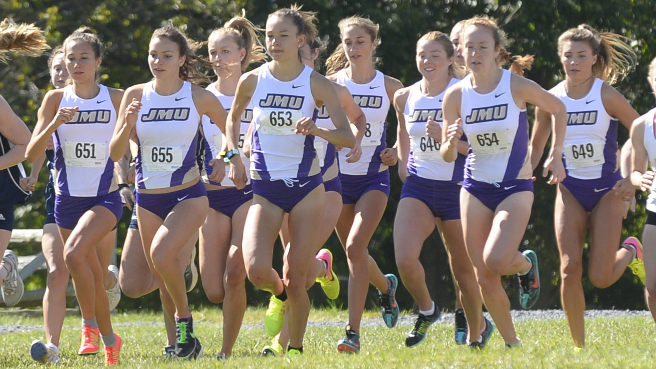 What distance should women run at the university level in cross-country championships in Canada?