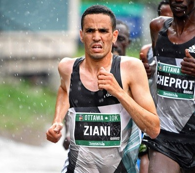 Morocco's Mohammed Ziani and Tigist Girma of Ethiopia beat the rain and cold weather to take top honours at the Guangzhou Marathon