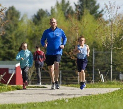 Erick Stark 8-year-old plans to run the Bayshore Half Marathon this weekend