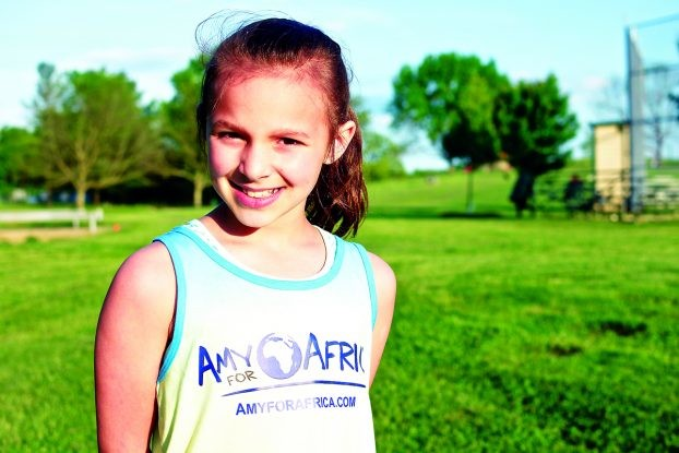 10-year-old Kinslee Wesolowski ran the Horse Capital half Marathon to help children in Uganda