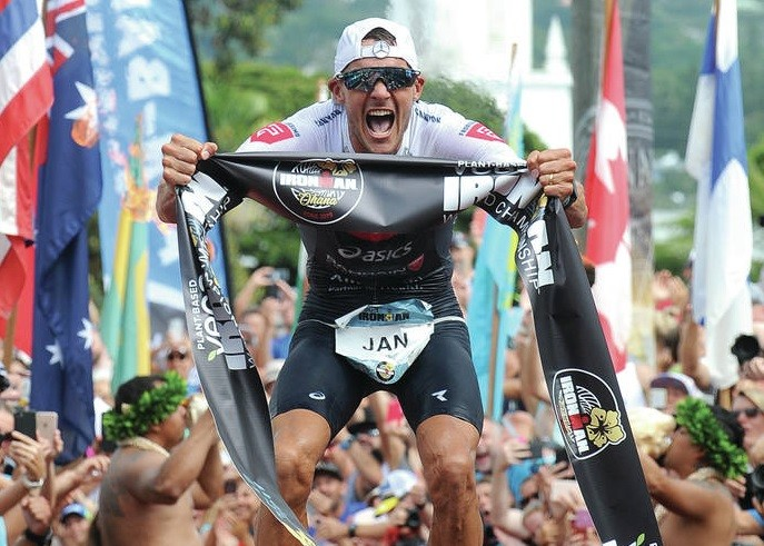 Germany's Jan Frodeno won his third Ironman World Championship triathlon in a course record time in Hawaii on Saturday
