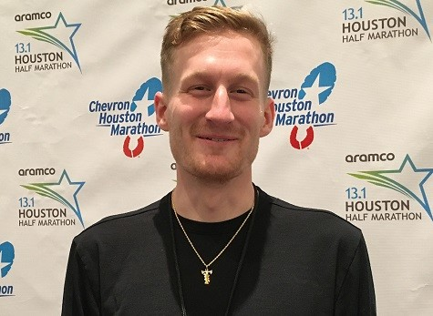 A year ago, Reed Fischer paid his own way to the Aramco Houston Half-Marathon this year he is excited for his return