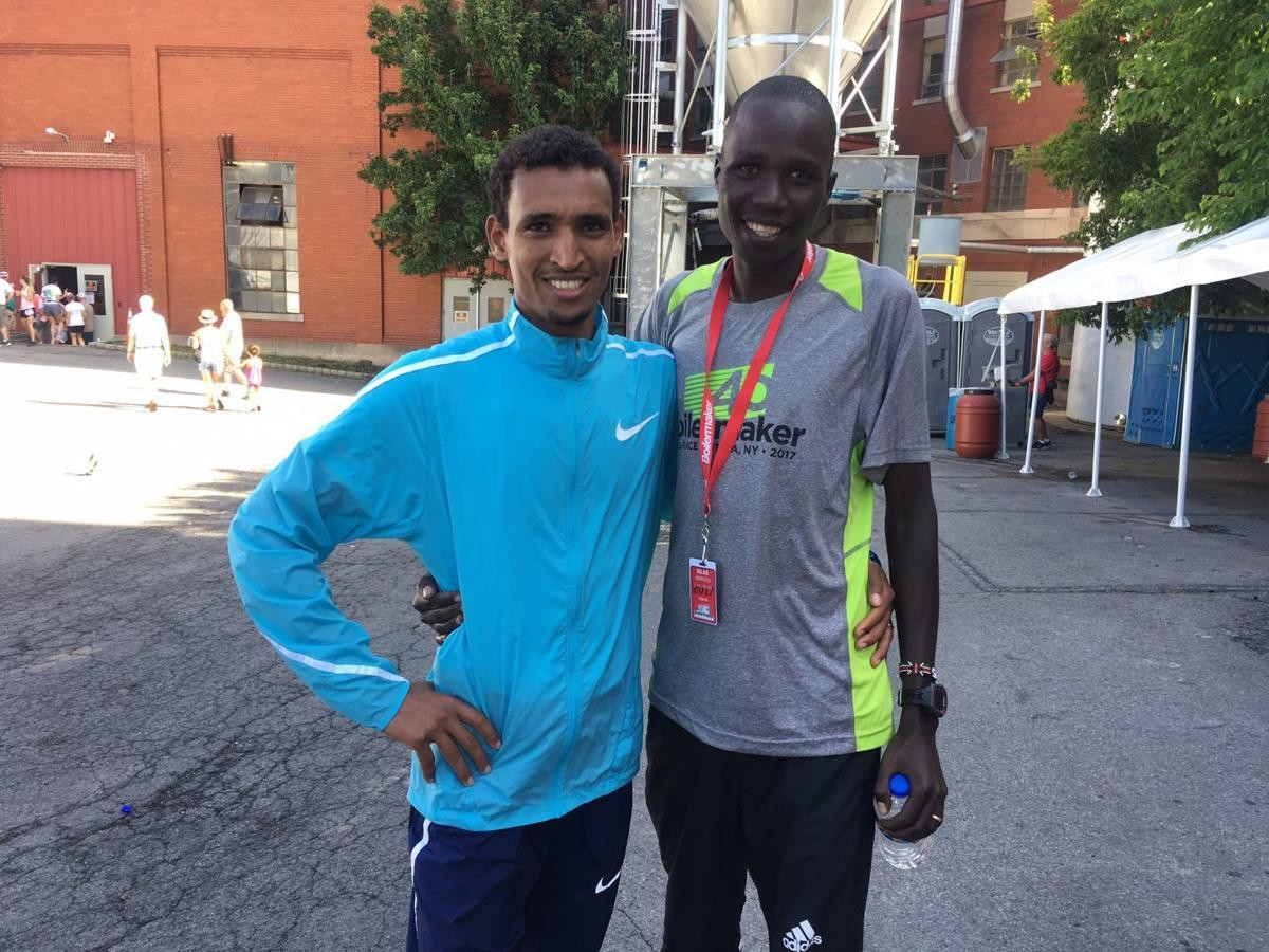 Two years ago Silas Kipruto was leading the Bix 7 when suddenly he whirled around and took a swipe at Mekonen, now they are friends