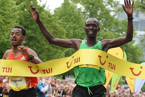 Kenyan athlete Joseph Kiprono was knocked down by a car  leading a half-marathon in Colombia