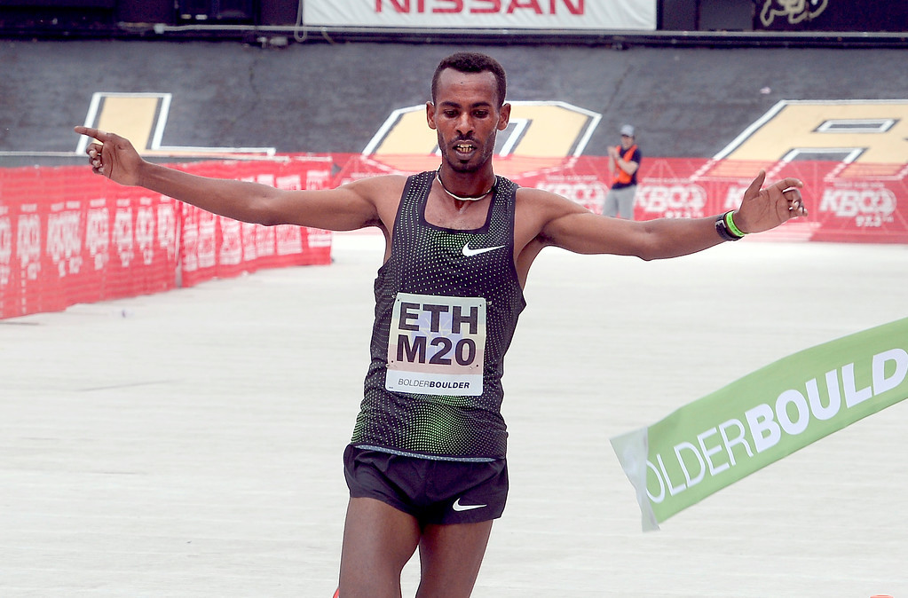 Ethiopia's Getaneh Tamire wins the men's pro race by wide margin at the 40th annual Bolder Boulder 10K