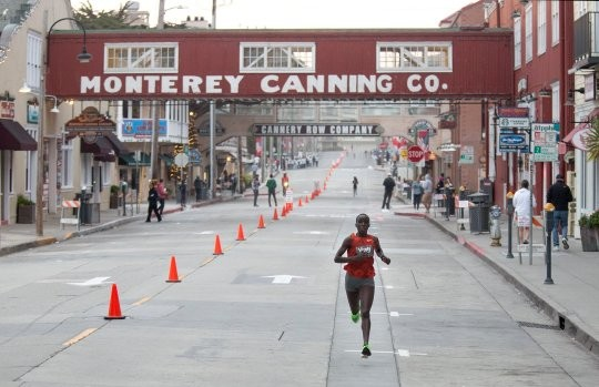 Vicoty Chepngeno was the first across the finish line at the 16th annual Monterey Bay Half Marathon holding off the elite men who started nine minutes and five seconds behind her