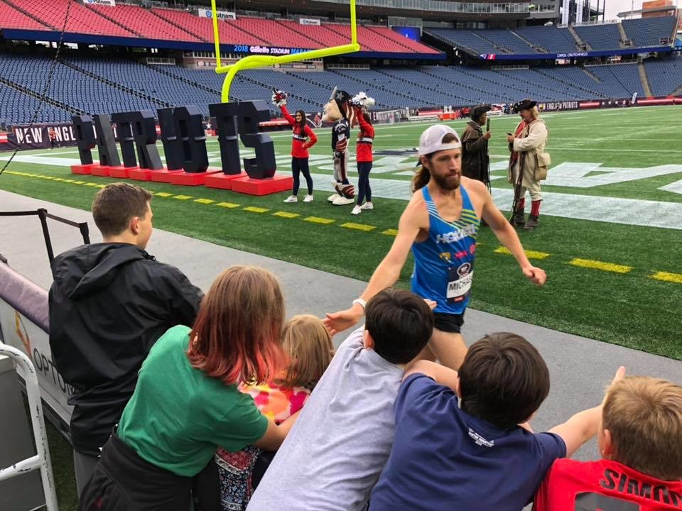 Michael Wardian wins the first ever full marathon held inside a NFL stadium