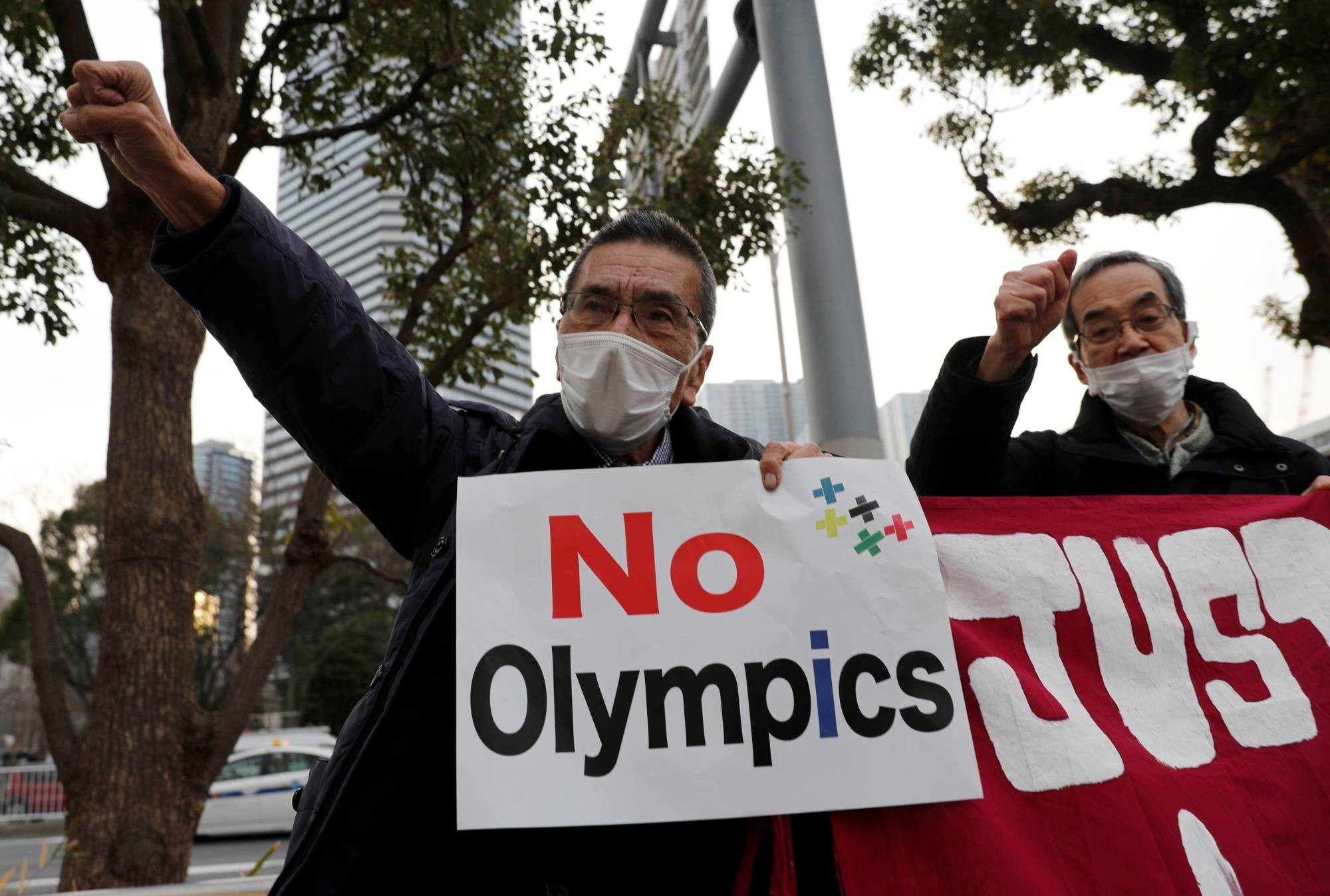 Survey shows that over half of Japan firms want Olympics cancelled or postponed
