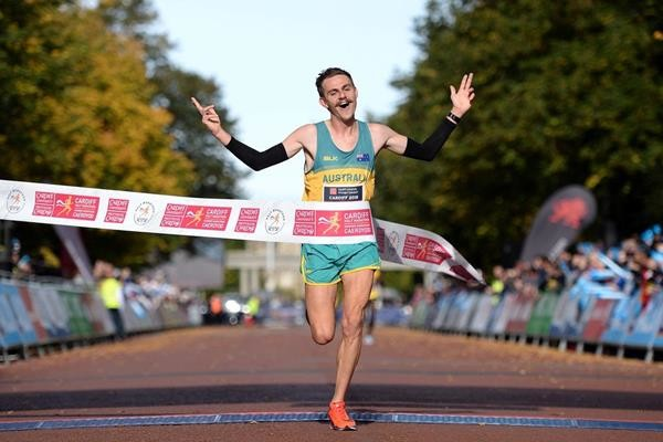 Jack Rayner of Australia and Uganda's Juliet Chekwel win at the Cardiff Half Marathon