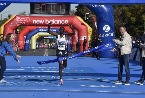 Ayenew and debutante Chekwel break course records at Seville Marathon
