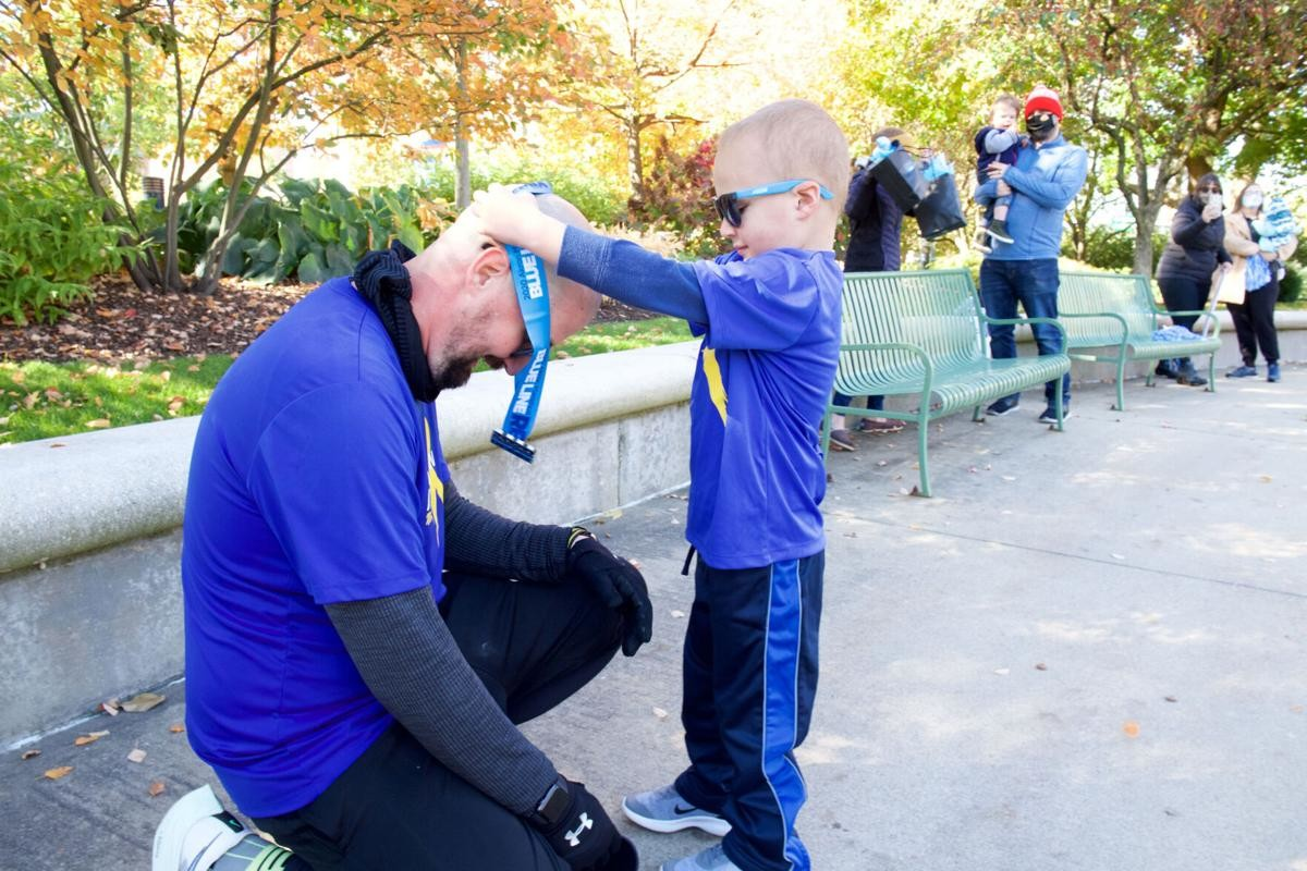 Kolt Codner runs his first marathon around hospital for 4-year-old son with cancer