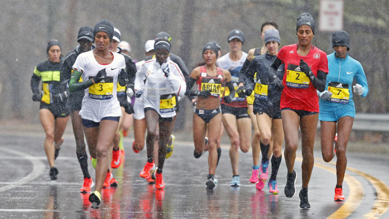 America's Desiree Linden beats the weather and is first American to win the  Boston Marathon in 33 years.