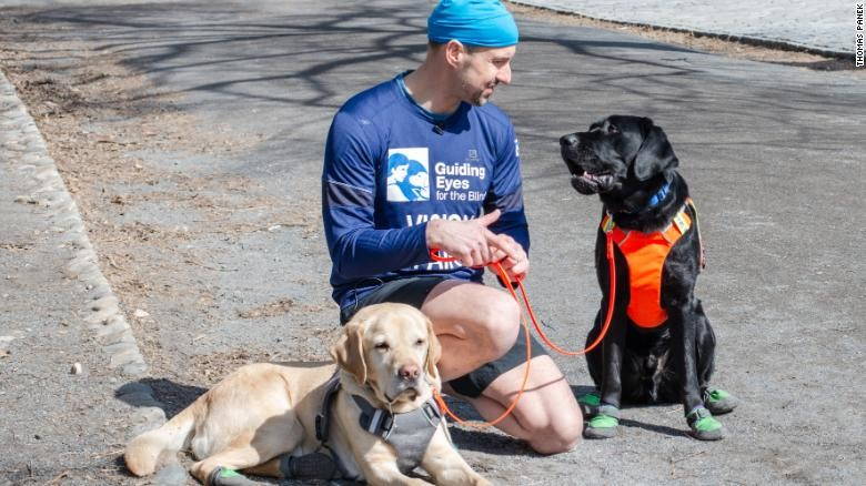 Thomas Panek is the first blind runner to complete the half marathon with guide dogs
