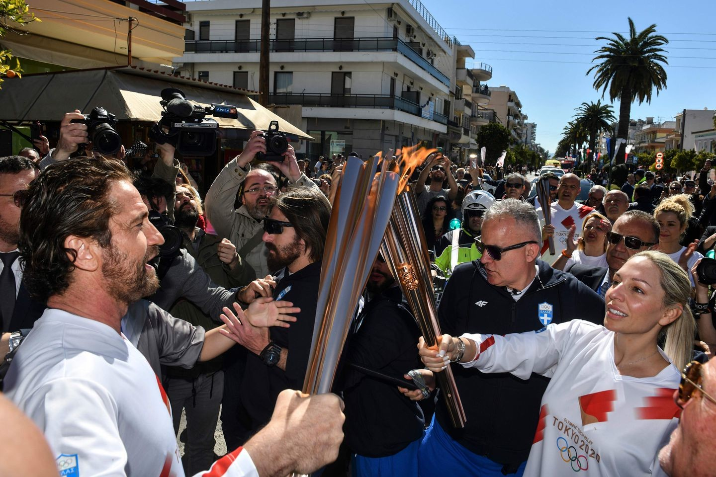 One day after flame was lit, Greece suspends Olympic torch relay because of coronavirus