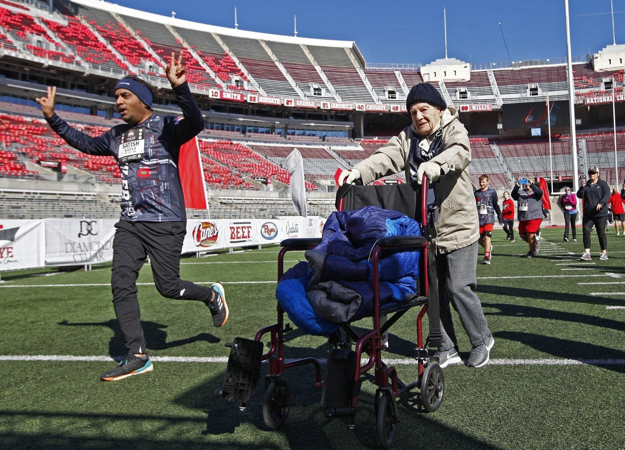 "Lois ""Marge"" Stroebel, age 101, crosses finish line at Ohio State 4 Miler"