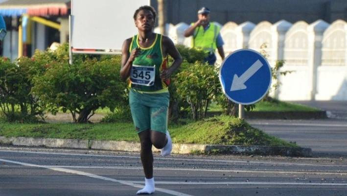 Margaret Kuras of Vanuatu wins half-marathon in socks, no shoes