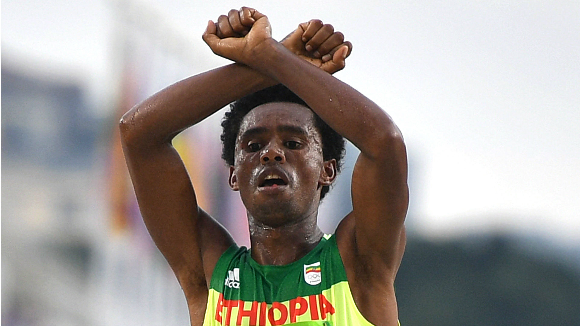 Olympic silver medallist Feyisa Lilesa had been in exile in the US since making this anti-government gesture