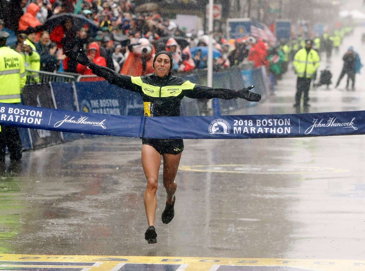 Desiree Linden this year was all alone as she crossed the finish line in Boston unlike in 2011