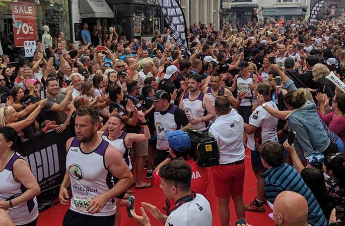 A group of 122 people broke the record for the most runners linked to complete a marathon