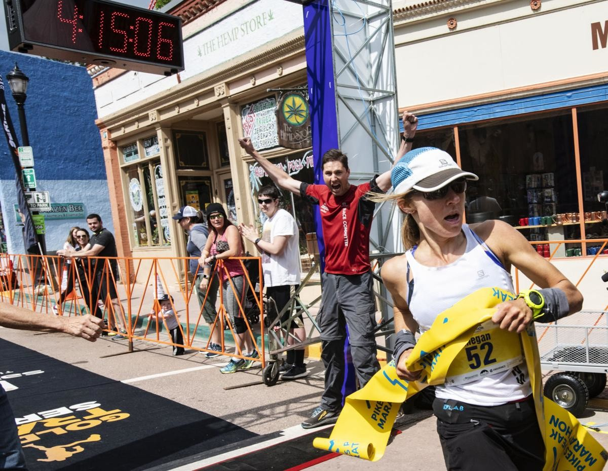Megan Kimmel crosses the finish line at the Pikes Peak Marathon to set a new women´s record