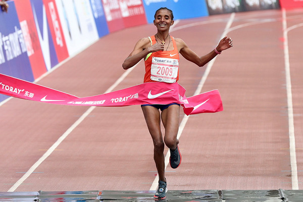 Ethiopia's Yebrgual Melese broke the women's course record by more than a minute at the Shanghai International Marathon on Sunday